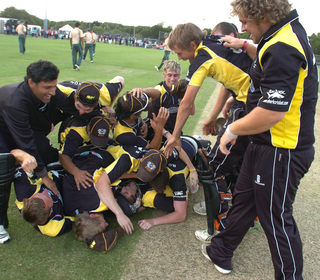 Midlands t20 celebrations: under there somewhere Lewis Bruce...