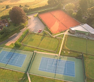 The clubhouse and 8 of our 18 courts