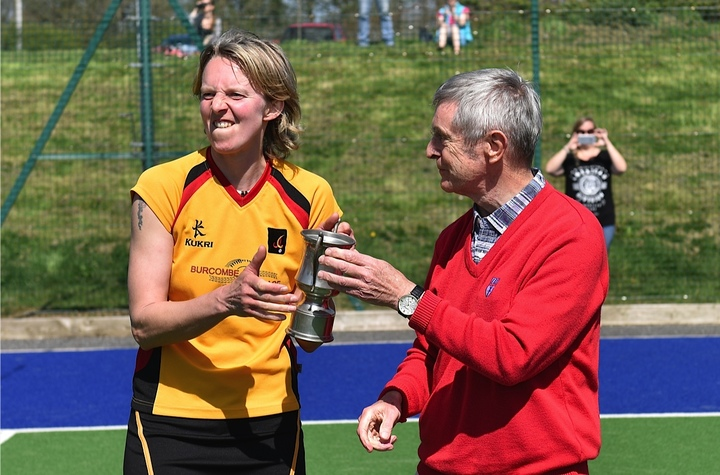 Caradon 1s Captain, Clare Poad, collects the Cornwall County Hockey Cup for the first time in the Club's history