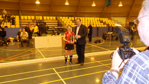 Vikki collecting the trophy