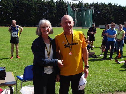 Phi Davies receiving his M60 silver medal for the Surrey Road League