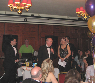 Tony skillfully passing speech duties over to club captains Eve and Nev