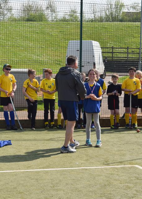 Annabelle Arrowsmith receives a medal from Coach Garry Nash