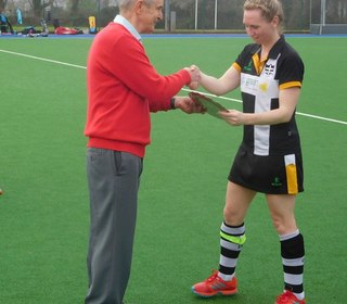 Women's 1s Captain, Jo Holding, receives the Women's Plate