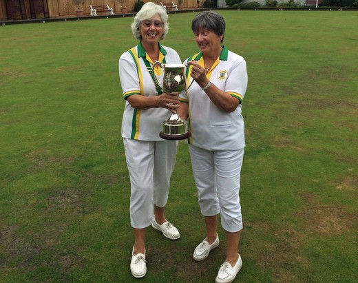 Ladies champion Chris Wilcock receives the trophy from president Kate Herbison