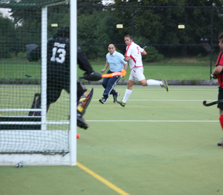 Chris Heath shoots on goal.