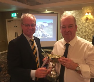 Clubman of the Year - junior co-ordinator Paul Judd, collected by Steve Parnell, r, with chairman Brian Howard