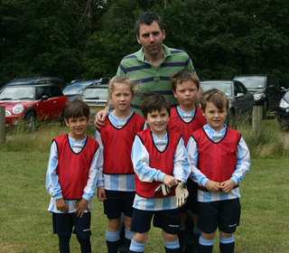 Spain (some U6s) with their manager El Neilros