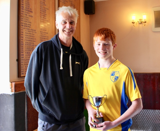 Mike Evans presents James Nash with 5th Team Player of the Year