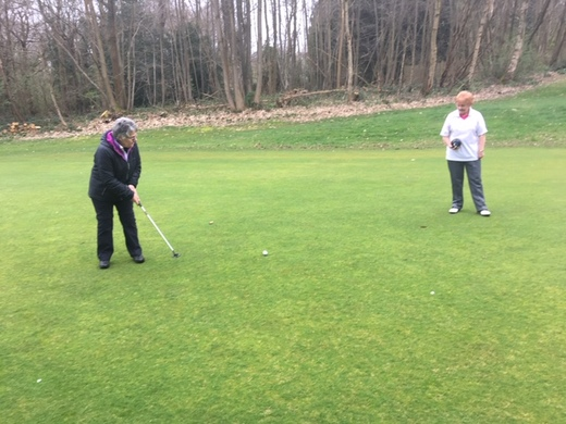 Sue Jelley putting out and Patricia dressed to play bowls