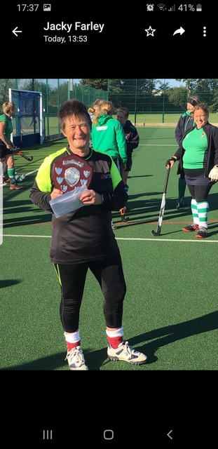 Julie R with the coveted Club Person's trophy
