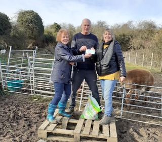 Patricia handing over cheque to the Trottiscliffe School Farm £1,580 her Charity in 2020