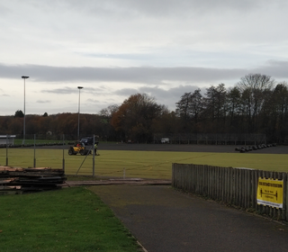 The folks from Shred & Recycle removing the old sand-filled pitch