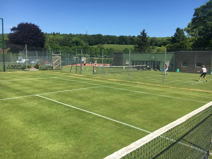 View across two of our grass courts to the clubhouse