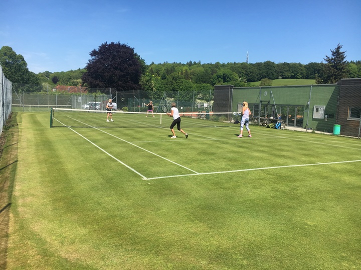 Ladies doubles on one of four grass courts