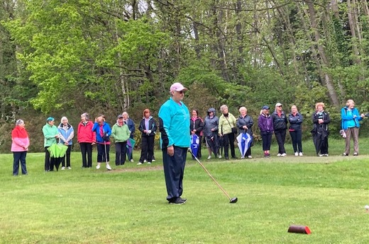 Jo about to tee off and ladies gather to watch