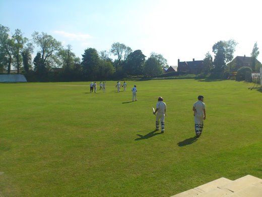 Clarke and Bruce walk out to bat during a typically tense contest at Market Overton, Sunday 1s