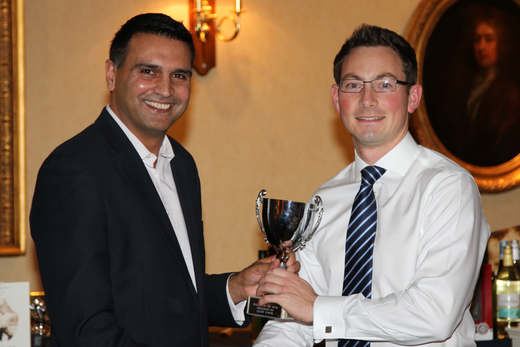 Outgoing captain Ajaz Akhtar presents Paul McMahon with 1st XI player of the year