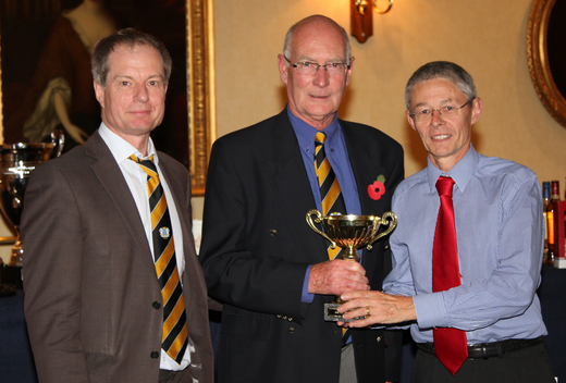 Chairman Brian Howard presents two of the groundstaff Ted Drake and Tony Brown with Clubmen of the Year award