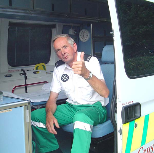 St. John's Ambulance operative seems pleased with the lack of visitors to his mobile office!