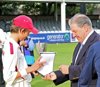 James Welham receives the spoils of victory!