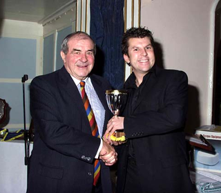 Neil Webb receiving the 4th XI Premiership Winners Cup from Fred Trueman.