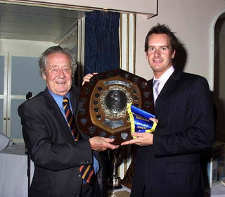 Jon Walford receiving the 1st XI Division One Winners Shield from Trevor Bailey.