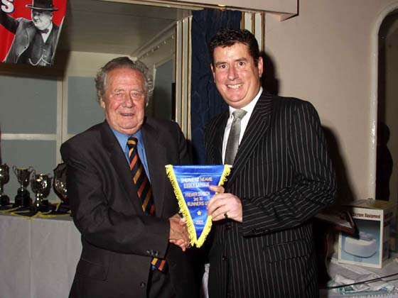 Rob Coote receiving the 3rd XI Premiership Runners-up pennant from Trevor Bailey.