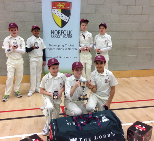 The spoils of success: A cup, medals and a Lord's Taverners kit bag full of equipment for the club!