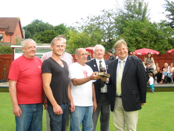 Winning team, Cottage Loaf, receive their trophy from Robin King