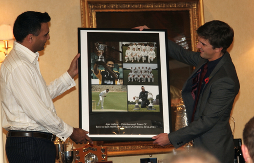 Ajaz Akhtar receives a presentation
