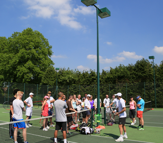 Our brillient guest Paul Hanley running the tennis clinic