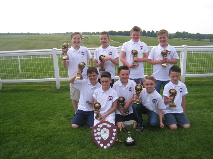 Current Under 11's team winning the double at the end of last season (2013/14), coming top of Division 2 and winning the cup.