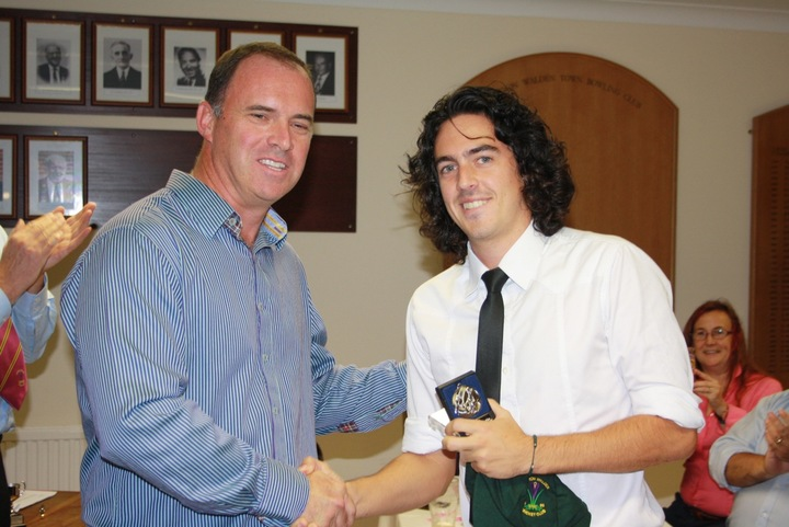 Giles Ecclestone congratulates Andrew Winton, winner of the HM Housden Memorial Cup for the Most Outstanding Cricketer and 1st XI player of the Year