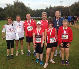 With medals after the Great Eastern Run, Peterborough, 12th, October, 2014. L to R. Jacquie Wood, John Richardson, Martin Strowger, Becky Hardy, Rory Campbell, Paula Olley, Ken Renshaw and Di Renshaw.