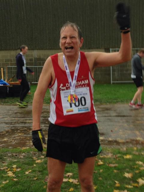 With medal in the pouring rain.