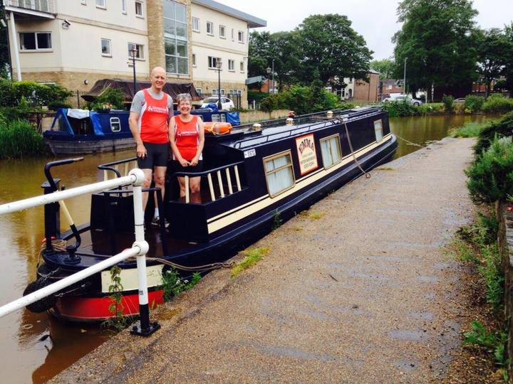 Ken and Di Renshaw arrive at the Worsley Woods parkrun near Manchester by the novel means of a Canal Narrow boat. (28/06/14)