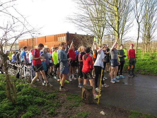 """The start of the Hackney Marshes parkrun. John Richardson has raised his arm in answer to the Race Director's question, """"Who is running at Hackney for the first time?"""" (08/02/14)"""