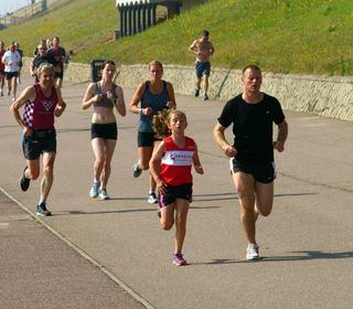 Dereham Runners junior Memphis Symonds takes on the field at the Gorleston Cliffs parkrun (4-07-15)