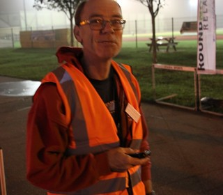 Dereham Runners' Vice Chairman Neville Knights, The Race Director of The Round Norfolk Relay on duty in 2014.