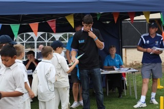 Boys receiving their certificates from Alastair Cook!