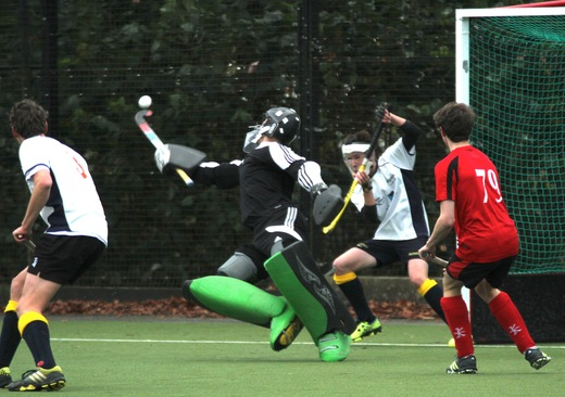 U18 Buccs GK Alex Witty tips a goal bound shot over the bar.