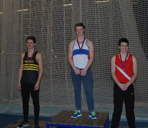 Tom Farres Collecting his medal for the Pole Vault