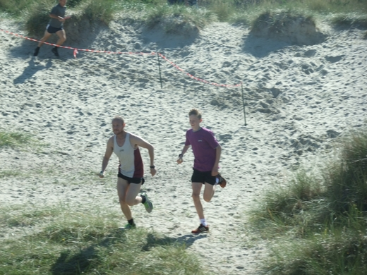 Nialls Davies & Jacob O'Hara running together stride for stride.