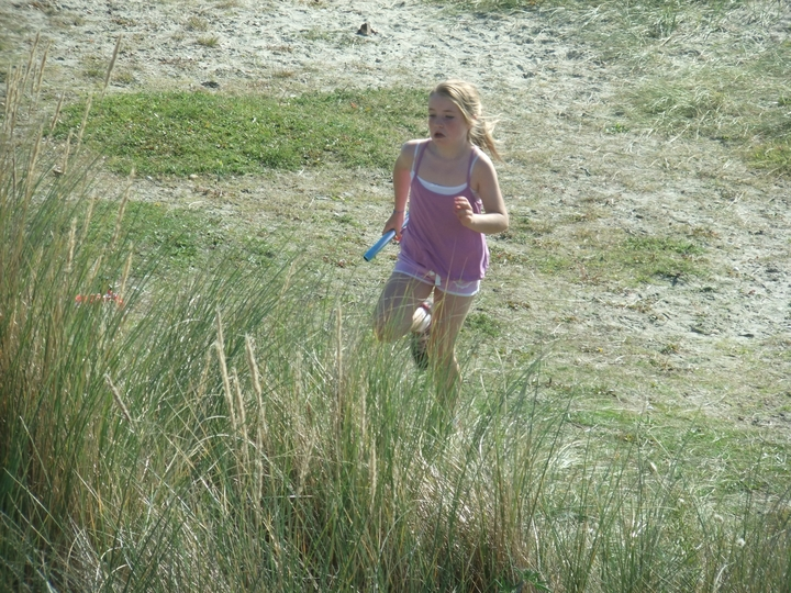 Rosa-May Sprake powering up yet another sand dune.