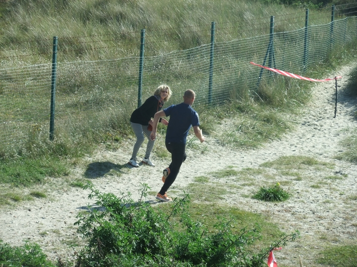Chris 'Scotty' powering along towards the next dune, being encouraged by an onlooker (who happened to belong to Havant AC many moons ago).