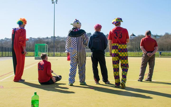 The Clowns wait for their first match
