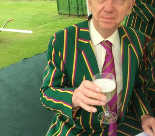The Chairman raises a glass..