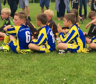 U8 Panthers waiting to be presented runners up at the Stockbridge Tournament